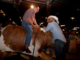 Several attendees gave the mechanical bull a try.