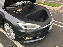 The Tesla Model SP100D is powered by a 100 kWh battery and has a range of over 300 miles on a...