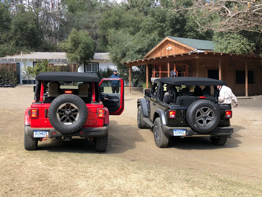 The 2018 Wrangler will be offered in three trim grades, including Sport (right), Sahara, and...