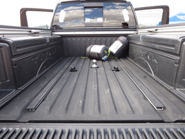 The Nissan Titan XD's bed is available with a number of options for storage and securing cargo.