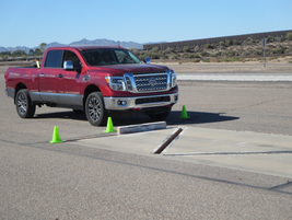 A professional Nissan driver demonstrates one of the punishing curb tests that the Titan XD was...