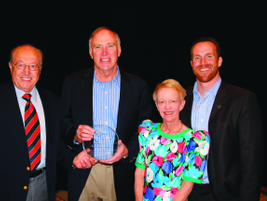 Tom Adams (center) of the Auction Insurance Agency received the IARA's Circle of Excellence...