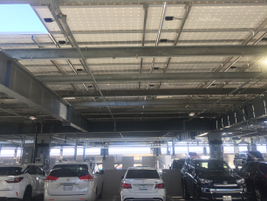 There are four parking structures, each with solar panel roofs. Thirty percent of the...