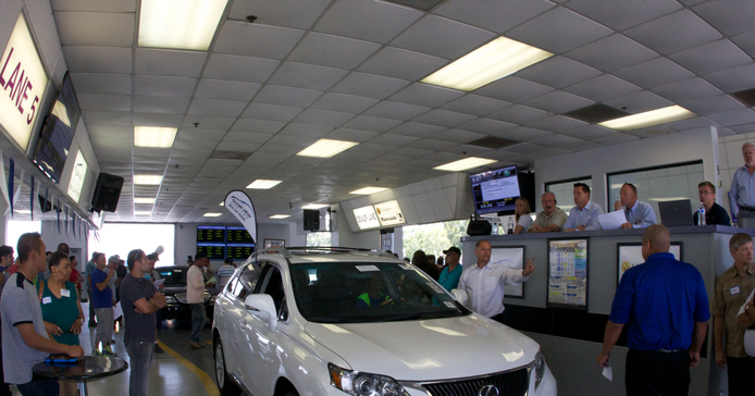 A vehicle arrives in the lane at Manheim Riverside's auction.