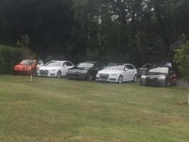 Several vehicles wait for drivers near the Ashby Inn.