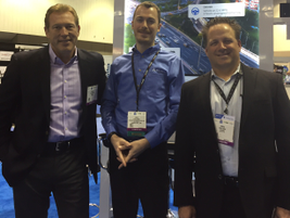 (l. to r.) Kevin Moore, Telogis' VP of OEM sales; Otto Schmid, Mitsubishi Fuso's director of...