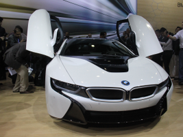 The 2014 BMW i8 plug-in hybrid supercar with gull-wing doors will arrive in the U.S. in the spring.