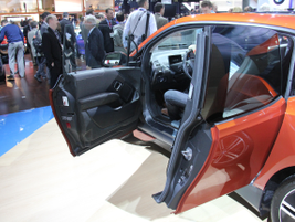 The i3 offers suicide doors as a design flourish. The vehicle retains the B pillar.