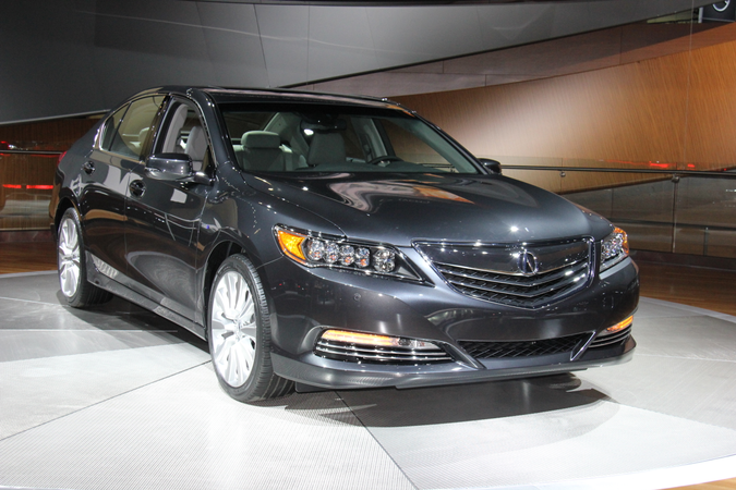 The 2014 Acura RLX offers a three-motor hybrid powertrain that includes a direct-injected V-6...