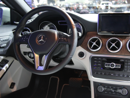 The GLA250 cockpit reveals a head-up display.