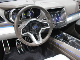 The Subaru Legacy Concept's cockpit includes a large dashboard display and other screens.
