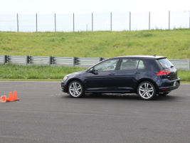 In the Dynamics Area, drivers must maneuver their vehicles through a line of cones set up in a...