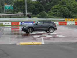 An Audi Q5 presented the toughest challenge to drivers on the wet surface due to its higher profile.