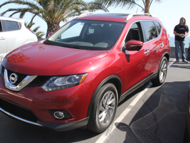 The front-wheel 2015 Rogue SL compact SUV has found a niche in commercial fleets.