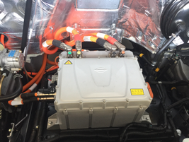 A battery charger is located under the hood. The battery packs charge two 74-kilowatt electric...