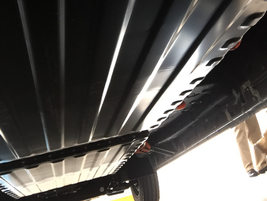 Two large 70-kilowatt-per-hour lithium-ion battery packs are mounted to the van's undercarriage.