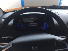 A instrument panel is illuminated with multiple colors and shows regenerative braking, charge...
