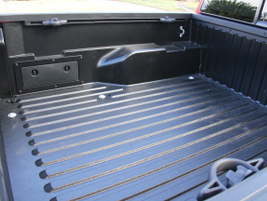 The standard bed uses a rail system and two foward U-mounts for cargo management.