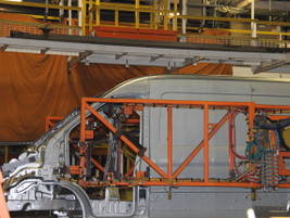 Framing robots set the bodysides and roof rails to the underbody and weld them into place.