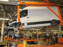 The step of the process shows powertrain installation for the unibody van.