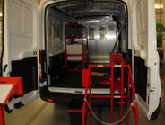 A corporate uniform service fleet added a lift and tank for cleaning fluid.