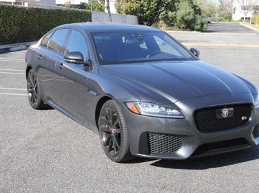 The XF is a mid-size luxury sport sedan.