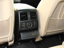 The rear of the center console includes HVAC controls and a BluRay player for rear-seat...