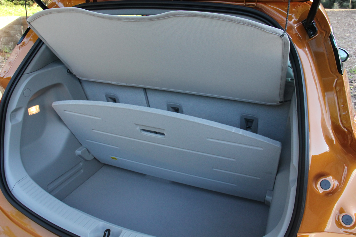 The 17 cubic feet of cargo space is supplemented by a hidden compartment where a spare tire...