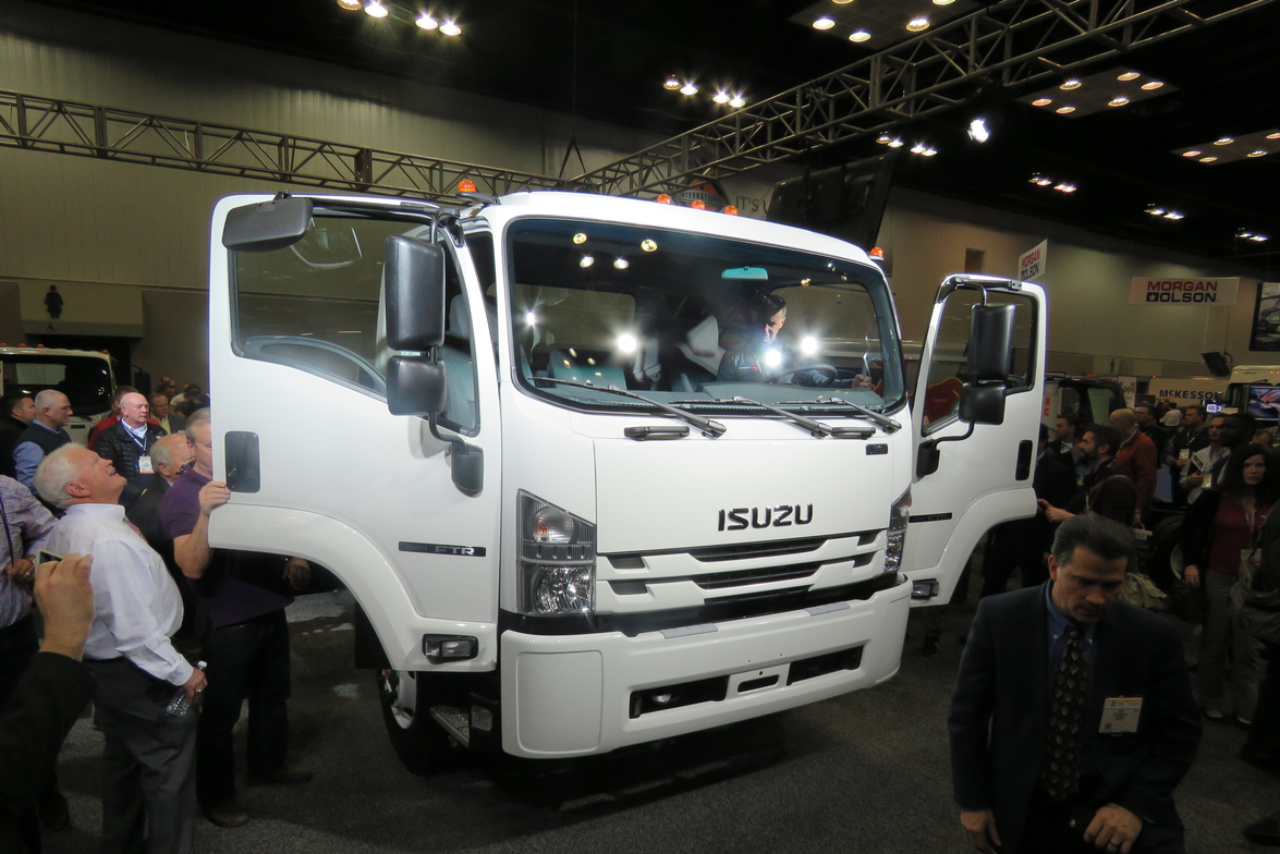 Showgoers mob the 2018 Isuzu FTR, the company's all-new entry in the Class 6 medium-duty truck...