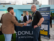 Paul Gillmore of Slick Technologies shakes hands with John Korte, mobility business leader at...