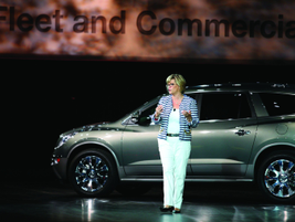 Jennifer Costabile, general dir., marketing & sales support, shows off the Buick Enclave.
