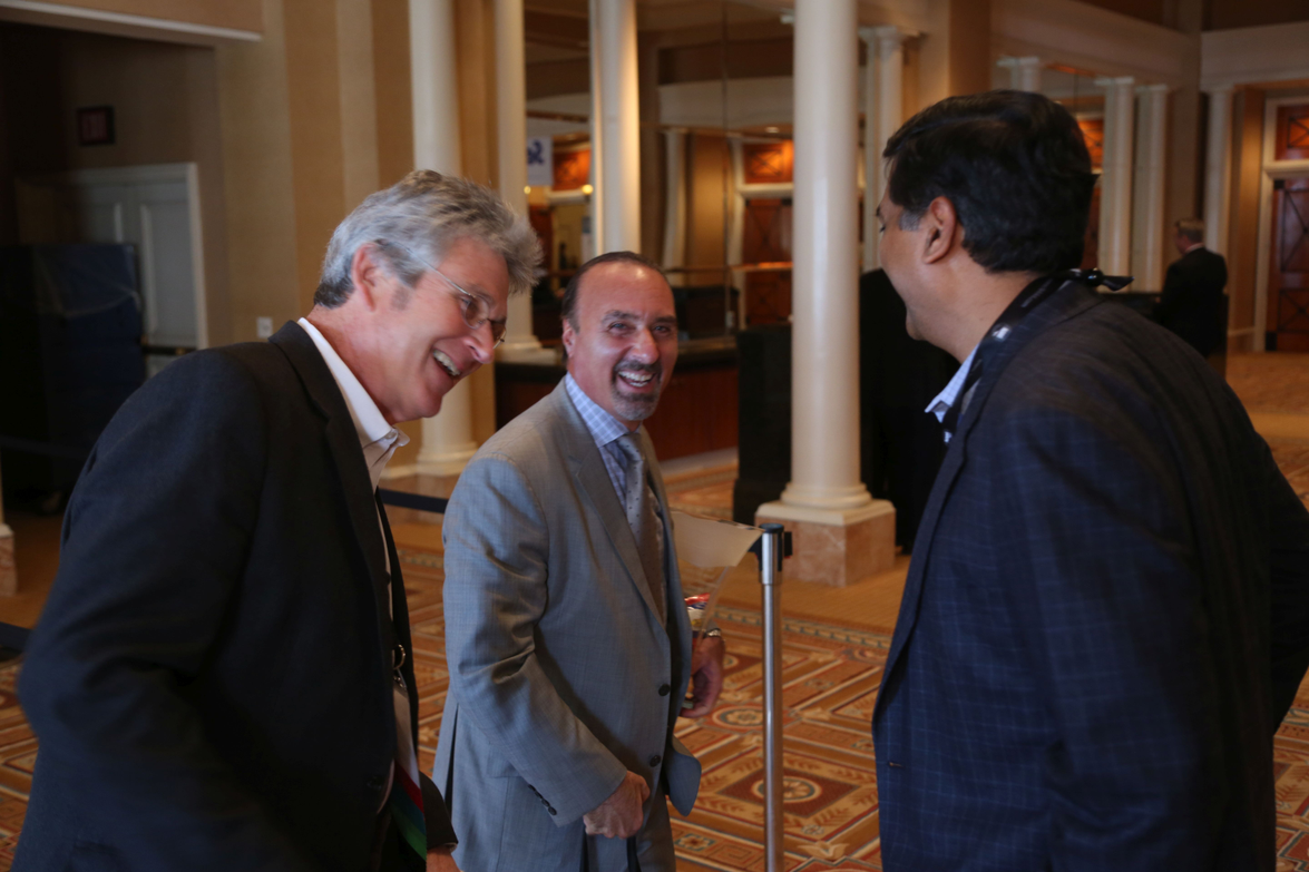 Ricky Beggs (left) of Black Book (retired), Tom Kontos of ADESA (center), and Anil Goyal of...