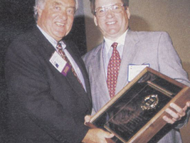 Ed receives the National Vehicle Leasing Association's Sam Lee Memorial Award during NVLA's...