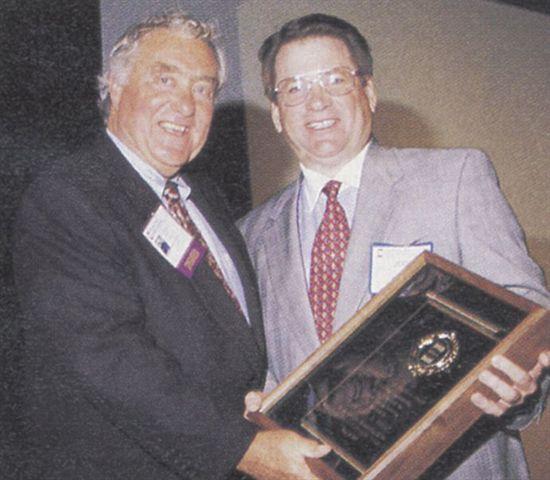 Ed receives the National Vehicle Leasing Association's Sam Lee Memorial Award during NVLA's...