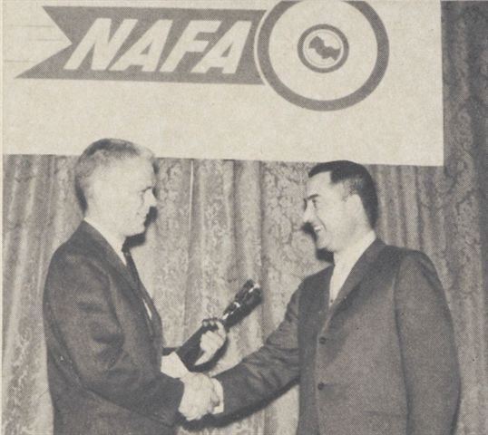 Ed presents Automotive Fleet's outstanding achievement award to Lee Westberg (left) at the 1965...