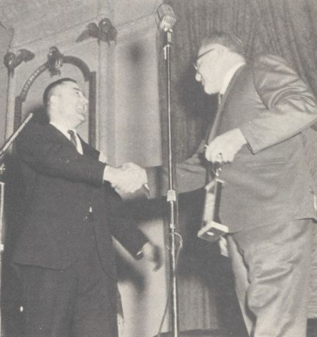Ed presents AF's Industry Contribution Award to the great Sam J. Lee at the 1963 NAFA banquet.