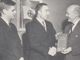In 1963, Ed (center) accepts a plaque from Howard Pyle, president of the National Safety...
