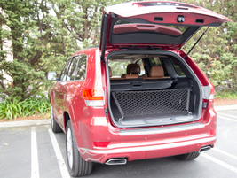 The Grand Cherokee's power liftgate opens when you activate a button above the license plate.
