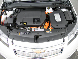 A 17.1 kilowatt-per-hour lithium-ion battery pack (right) and 1.4L gasoline engine (center)...