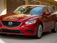 The front-wheel-drive Mazda6 (Touring trim shown) gets a mid-cycle refresh for 2016.