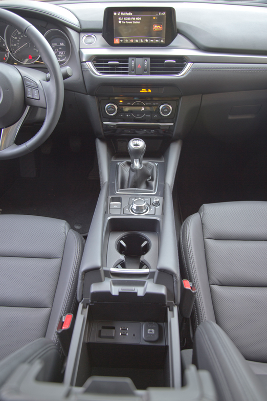 An electronic parking brake replaces a mechanical parking brake. The buttons surrounding the...