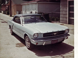 Gail Wise reportedly purchased the first Ford Mustang, a convertible model seen in front of her...