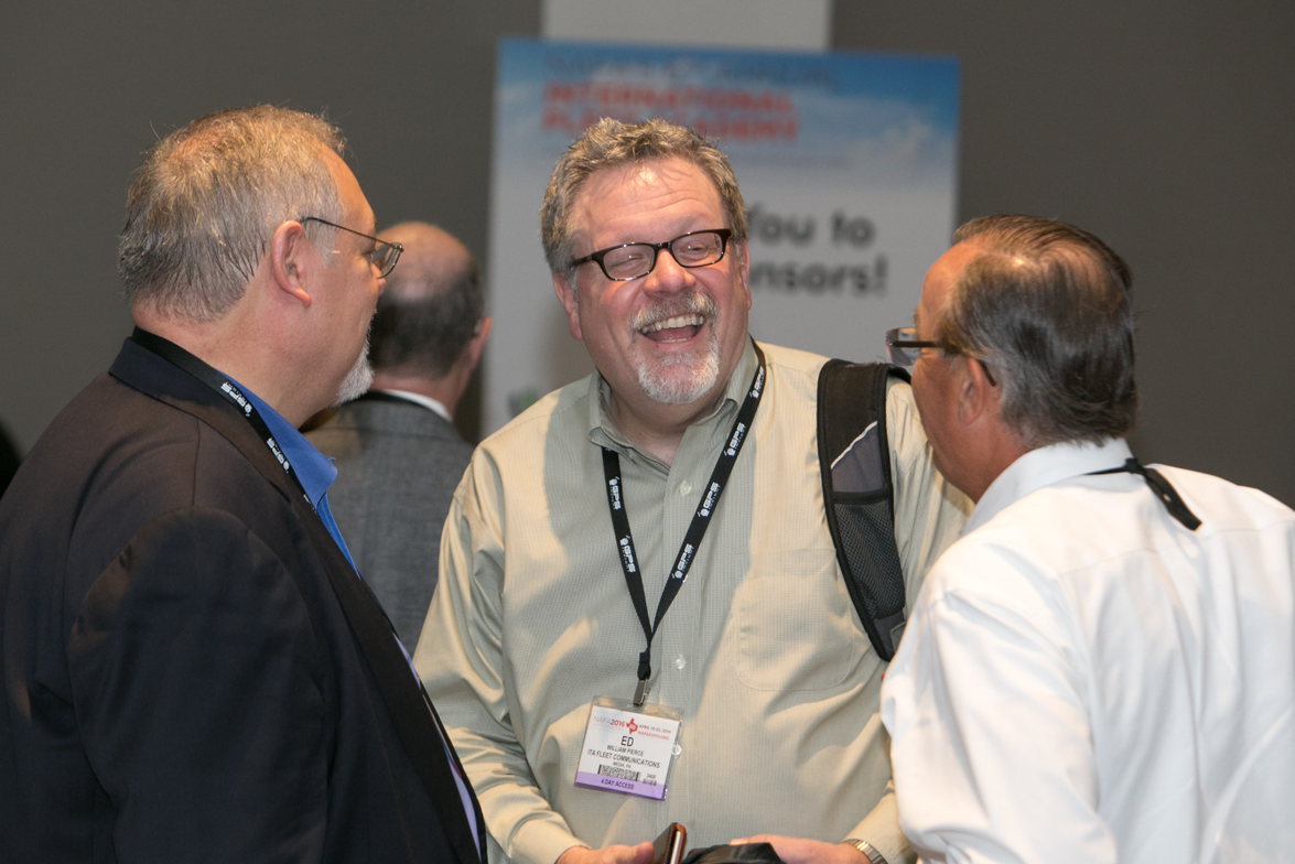 Rob Hill of ARI (left) catches up with Ed Pierce (center) and Wayne Smolda (right) of the CEI...