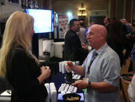 An attendee and supplier during the opening night event. Photo Steve Reed
