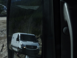 The yellow triangle in the side-view mirror notifies the driver of a passing vehicle. Blind Spot...
