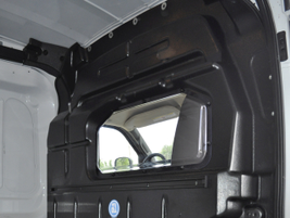 Adrian Steel's partition helps separate the driver compartment from the cargo area and quiet the...