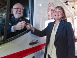 Janet Lawson (right), director of the Ford Motor Company Fund, hands the keys to Lt. Col. John...