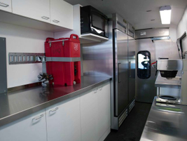 This Transit houses a custom-installed two-burner stovetop, microwave, coffeemaker,...