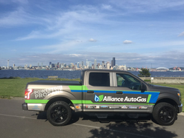 The truck cruises along the west Coast with Seattle in the background. (PHOTO: Alliance AutoGas)
