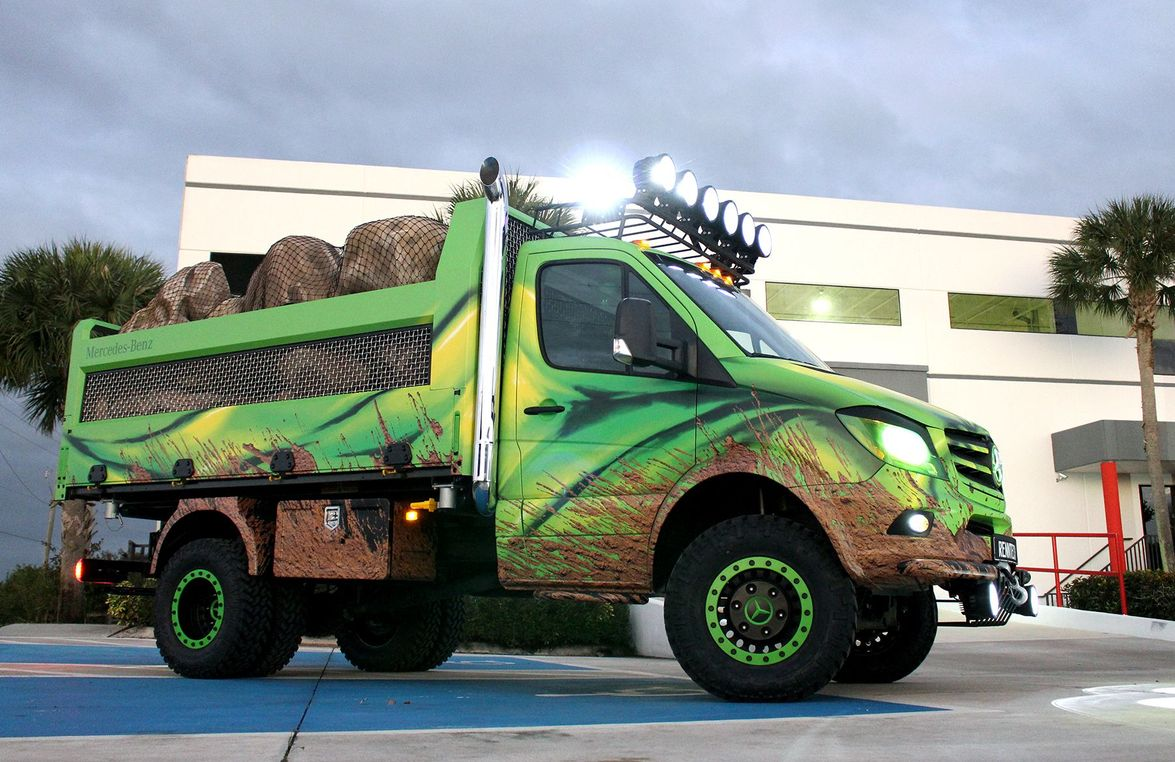 The vehicle has a suspension lift package, beadlock wheels, and off-road tires with custom...